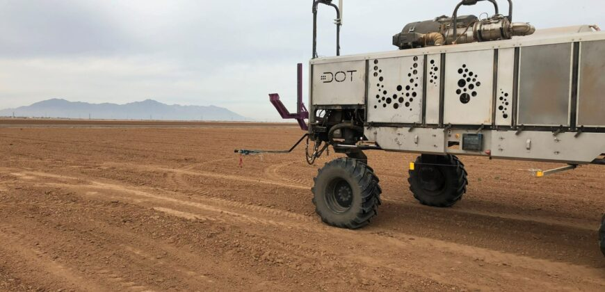 The Dot Power Platform in the field. Dot is a unique U-shaped diesel-powered platform designed to autonomously handle a large variety of agriculture implements.