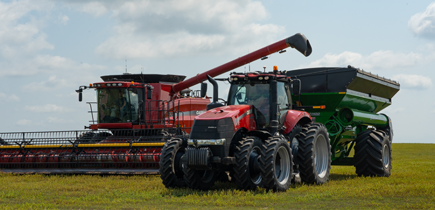 OMNiDRIVE performing grain cart operations autonomously in a field